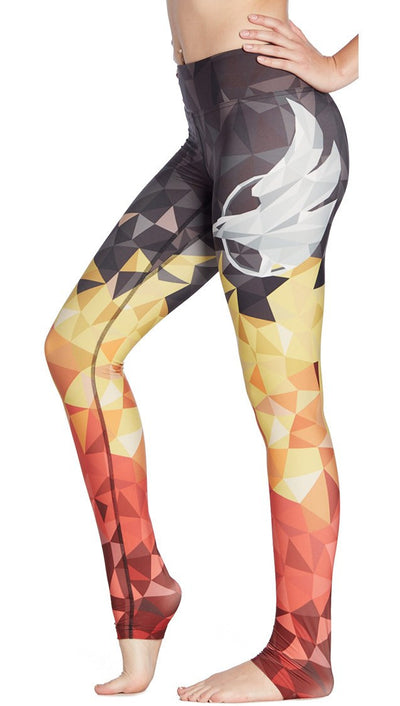 close up side view of ombre flame polygpon themed printed full length leggings with large eagle on the side