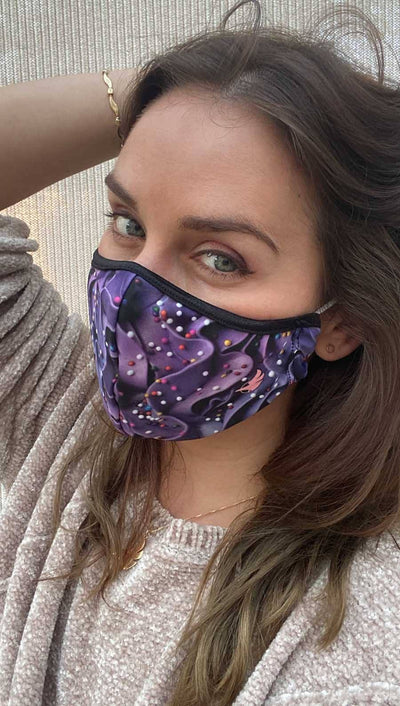 Slightly turned left side view of model wearing a purple frosting mask with colorful sprinkles and the WERKSHOP logo in pink on the bottom corner