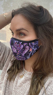 Left side view of model wearing a purple frosting mask with colorful sprinkles and the WERKSHOP logo in pink on the bottom corner