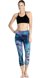 front view of model wearing jellyfish themed printed capri leggings