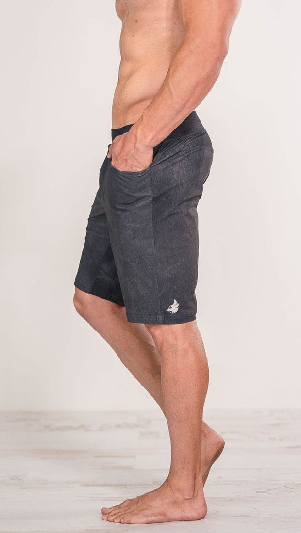 close up left side view of model wearing gray mens performance shorts
