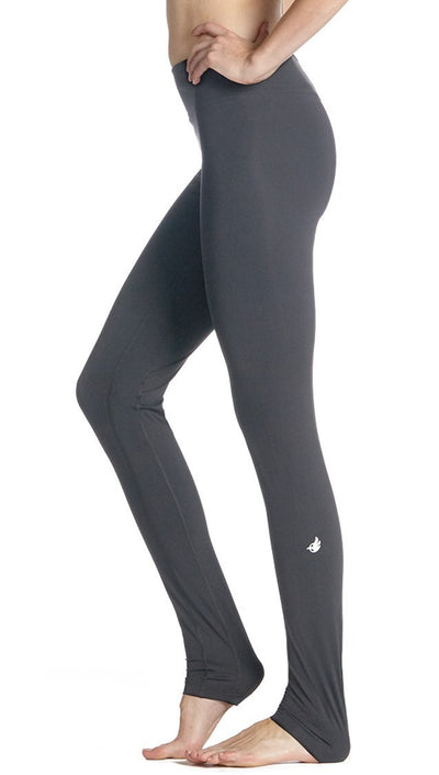 side view of full length grey compression leggings with reflective eagle logo