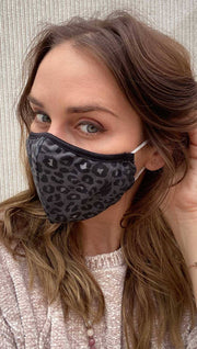 girl wearing charcoal leopard face mask.