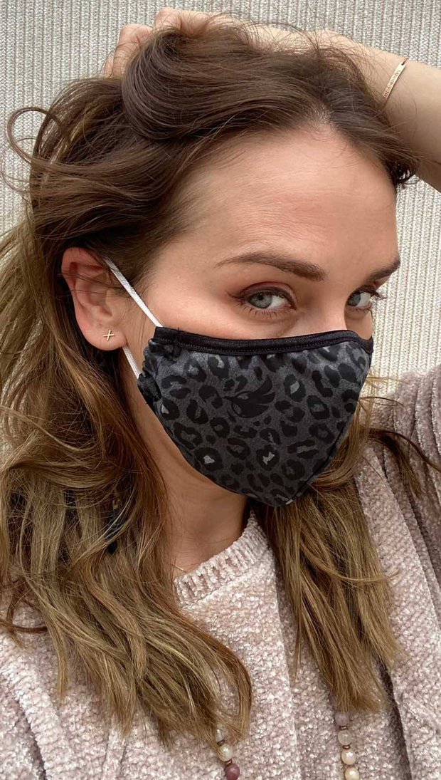 girl wearing charcoal leopard printed face mask