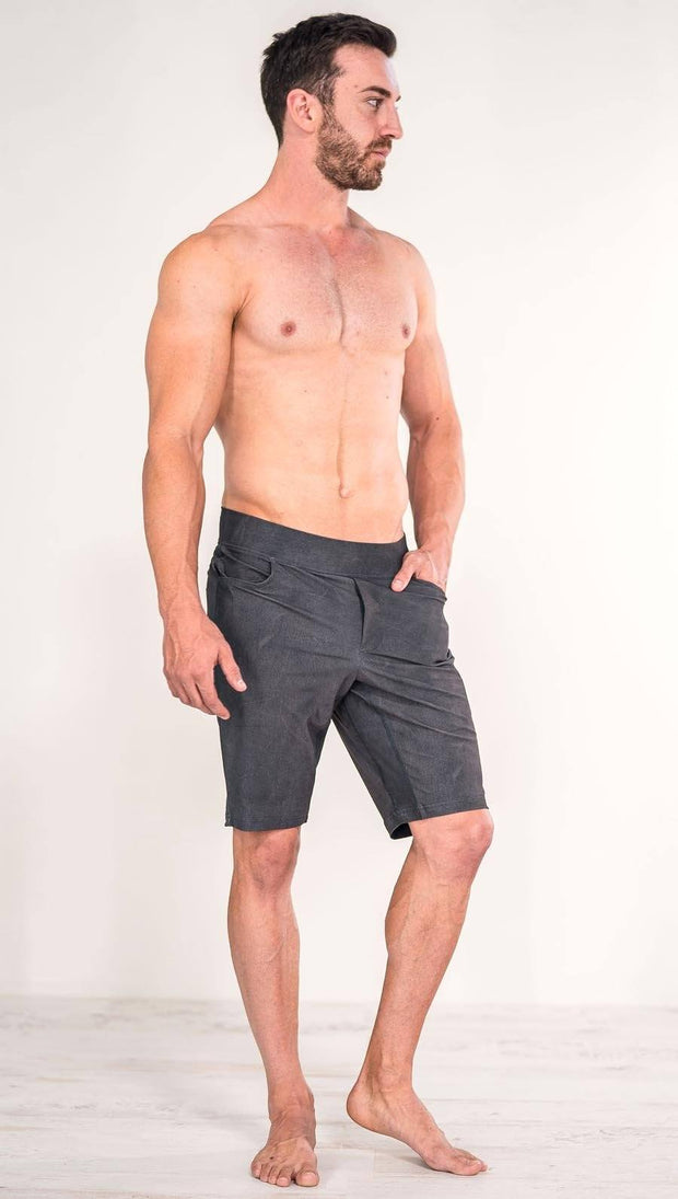 Front view of model wearing gray men's performance shorts