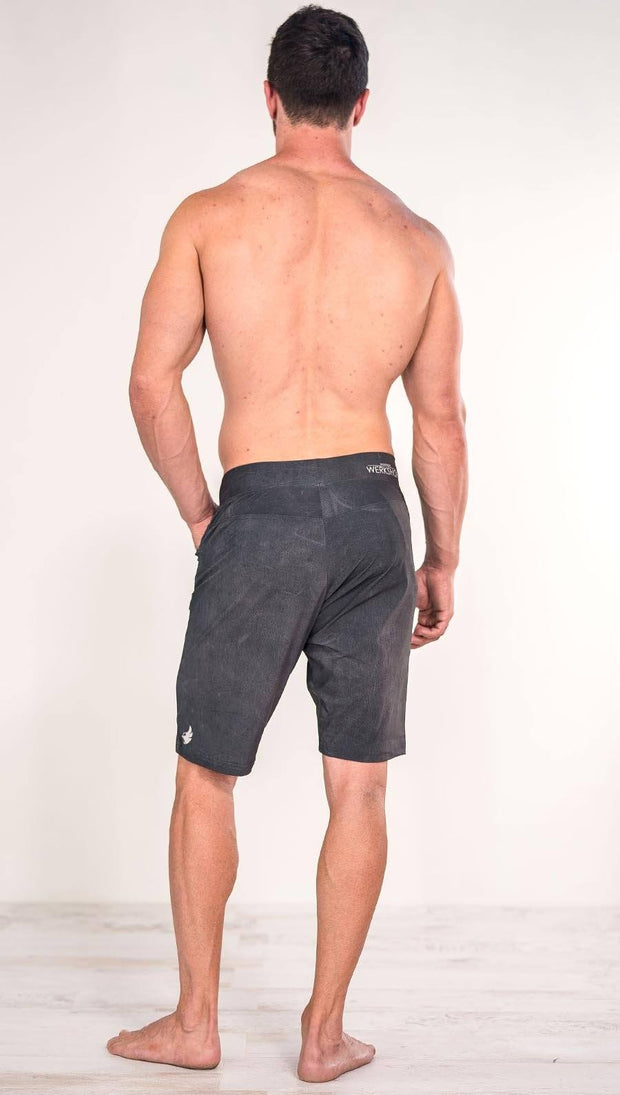 Back view of model wearing gray men's performance shorts