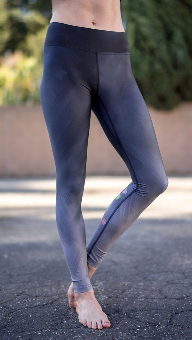 closeup front view of model wearing rose themed full length leggings