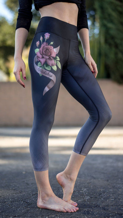 right side view of model wearing rose themed capri leggings