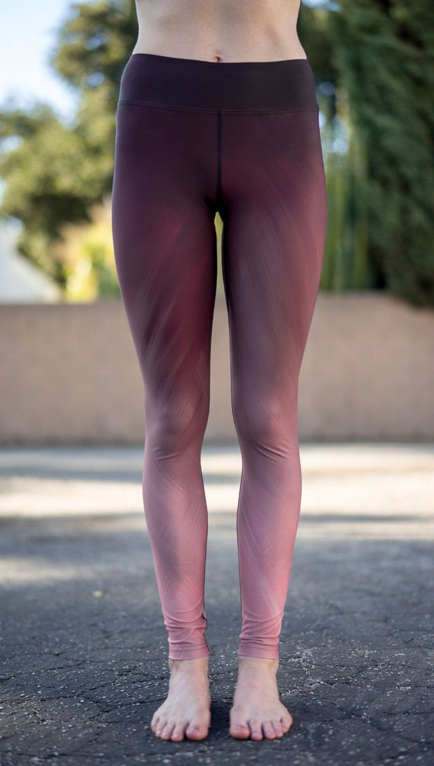 closeup front view of model wearing tattoo rose design printed capri leggings