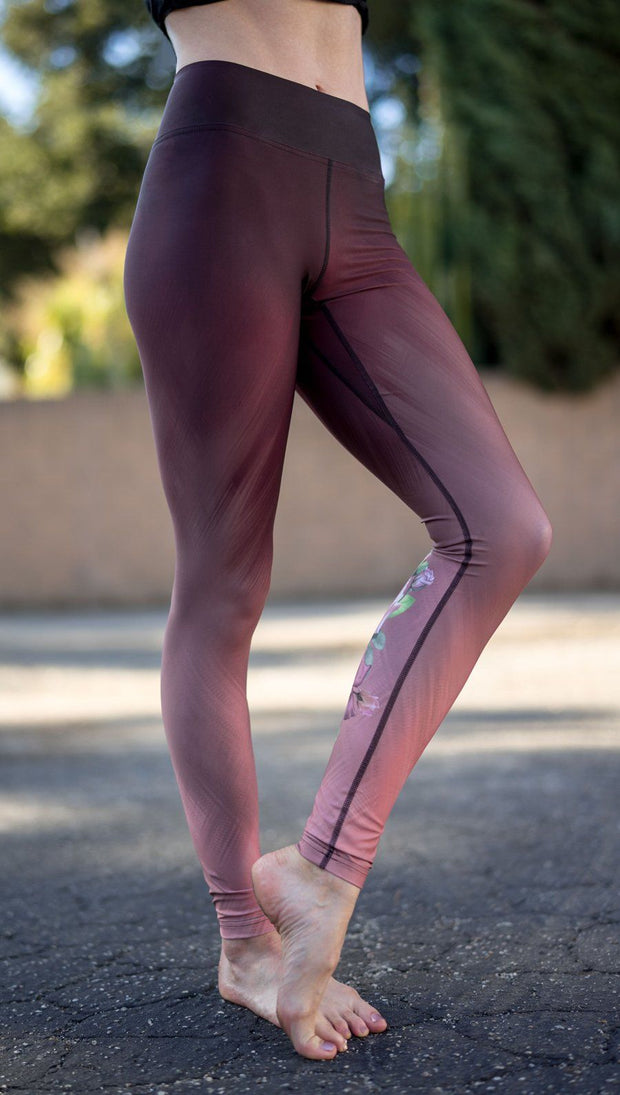 closeup right side view of model wearing tattoo rose design printed capri leggings