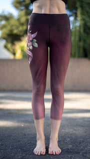 closeup back view of model wearing tattoo rose design printed capri leggings