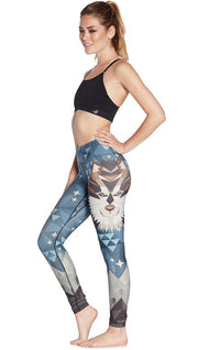 left side view of model wearing wolf / dog themed printed full length leggings
