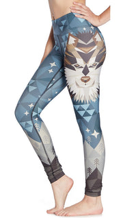 close up left side view of model wearing wolf / dog themed printed full length leggings