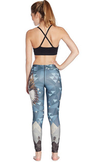 back view of model wearing wolf / dog themed printed full length leggings