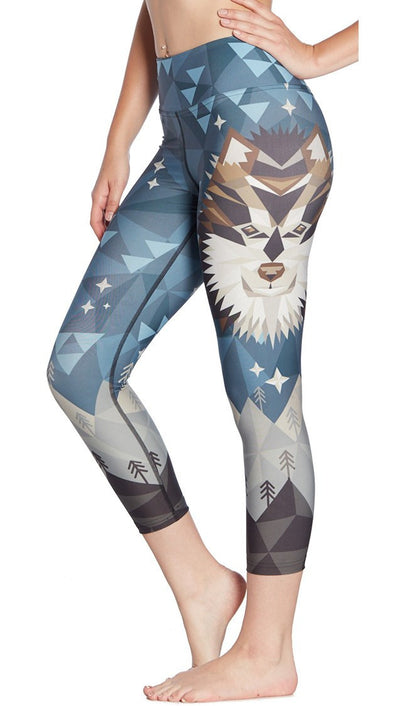 close up side view of geometric wolf / dog face printed capri leggings