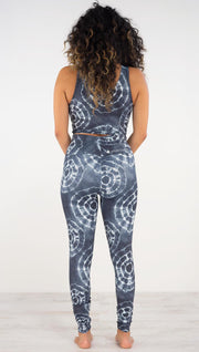 Back view of model wearing the indigo circles athleisure leggings. they are in a indigo color and have white tie dye circles throughout. Each circle has a smaller circle within each other.