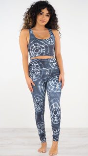 Front view of model wearing the indigo circles athleisure leggings. They are in a indigo color and have white tie dye circles throughout. Each circle has a smaller circle within each other.