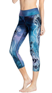 close up front view of model wearing jellyfish themed printed capri leggings