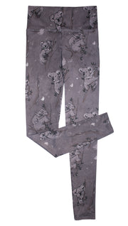 Koala leggings with tree branches and leaves on top of white background