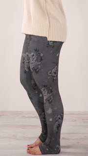 Left side view of model wearing koala leggings with tree branches and leaves