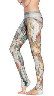 close up left side view of model wearing koi fish themed printed full length leggings