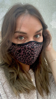 Front view of model wearing a purple leopard print mask