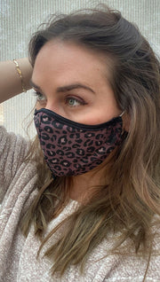 Left view of model wearing a purple leopard print mask