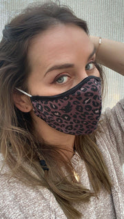 Right view of model wearing a purple leopard print mask