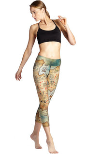 front view of model wearing treasure map themed printed capri leggings