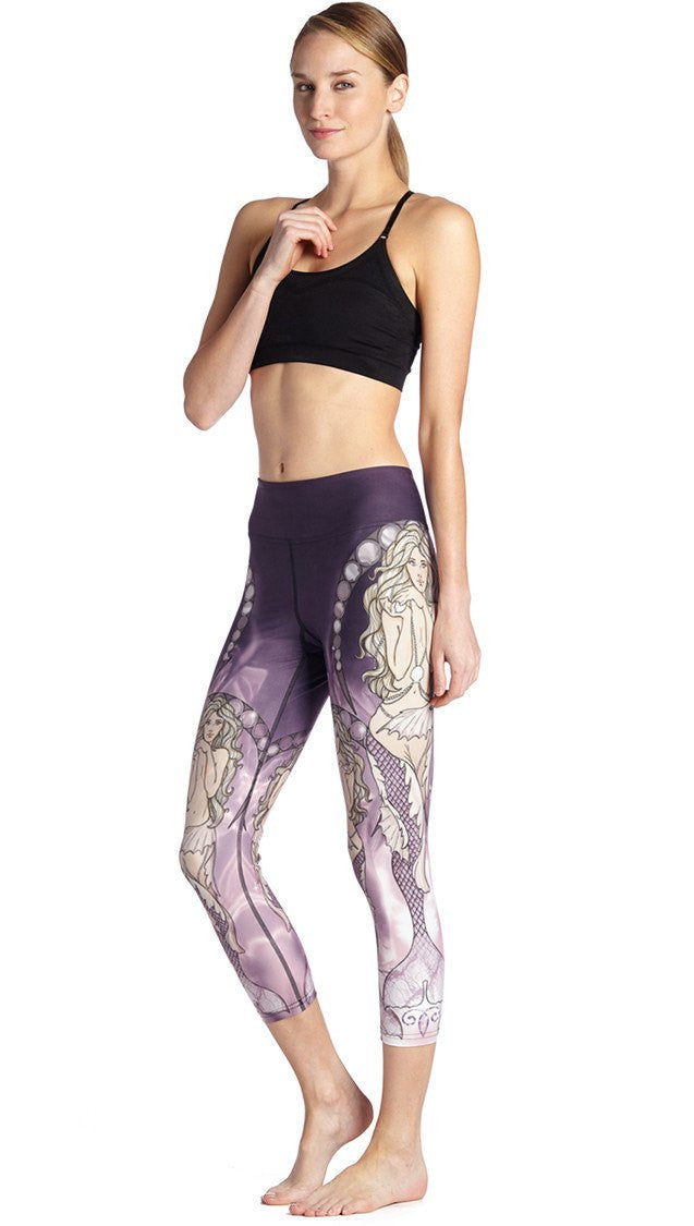 close up side view of model wearing mermaid themed printed capri leggings