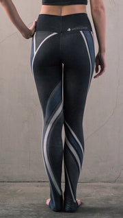 back view of model wearing midnight blue colored motocross inspired printed full length leggings