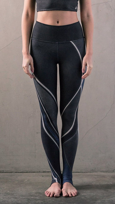 close up front view of model wearing midnight blue colored motocross inspired printed full length leggings