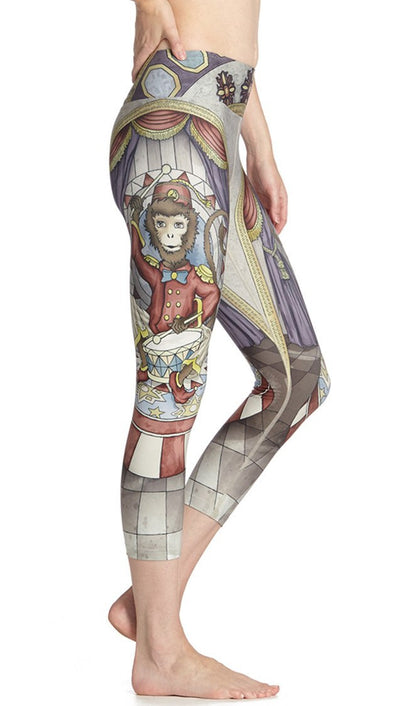 close up side view of vintage circus monkey themed printed capri leggings