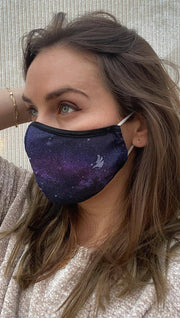 Left side view of model wearing a purple mask with tiny white stars and the WERKSHOP logo in the bottom corner
