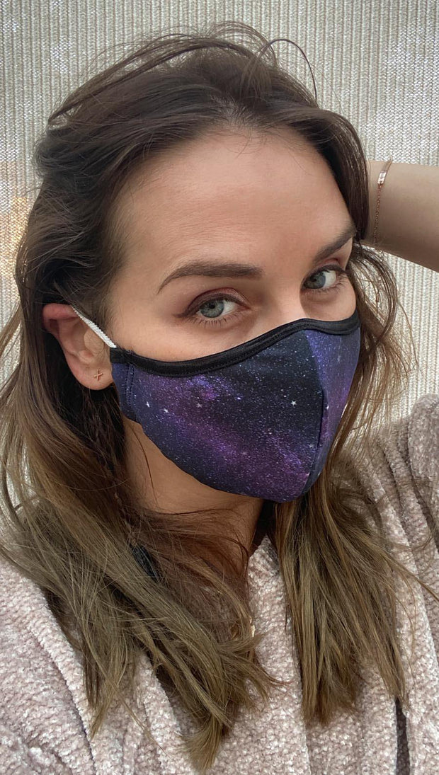 Right side view of model wearing a purple mask with tiny white stars