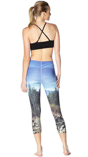 back view of model wearing New Zealand mountain themed printed capri leggings