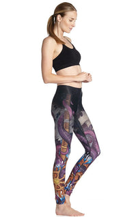 right side view of model wearing mythical octopus themed printed full length leggings