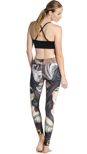 back view of model wearing pirate girl themed printed full length leggings
