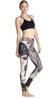 right side view of model wearing pirate girl themed printed full length leggings