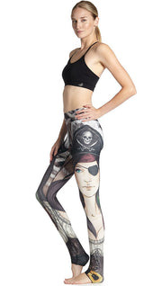left side view of model wearing pirate girl themed printed full length leggings