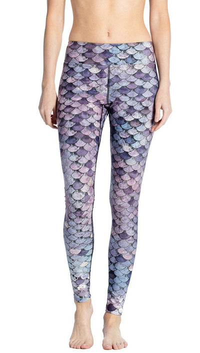 close up front view of model wearing purple mermaid scale themed printed full length leggings