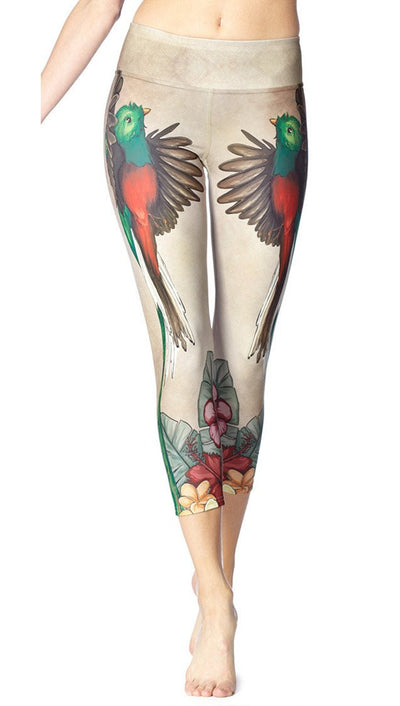 close up front view of quetzal bird themed printed capri leggings