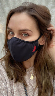 Girl wearing black face mask with red trim logo and adjustable ear loops