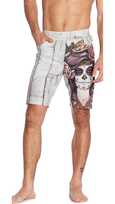 front view of light colored sugar skull inspired printed mens shorts