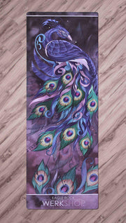 Top View of Peacock Yoga Mat. Artwork is printed with peacock feathers fanning across the mat with our WERKSHOP logo on the bottom