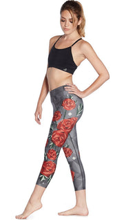 left side view of model wearing geometric roses themed printed capri leggings