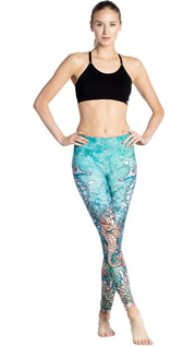 front view of model wearing colorful seahorse themed printed full length leggings