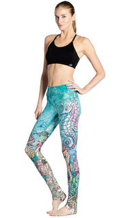 left side view of model wearing colorful seahorse themed printed full length leggings