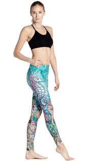 right side view of model wearing colorful seahorse themed printed full length leggings