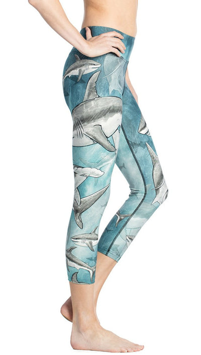 close up side view of shark themed printed capri leggings